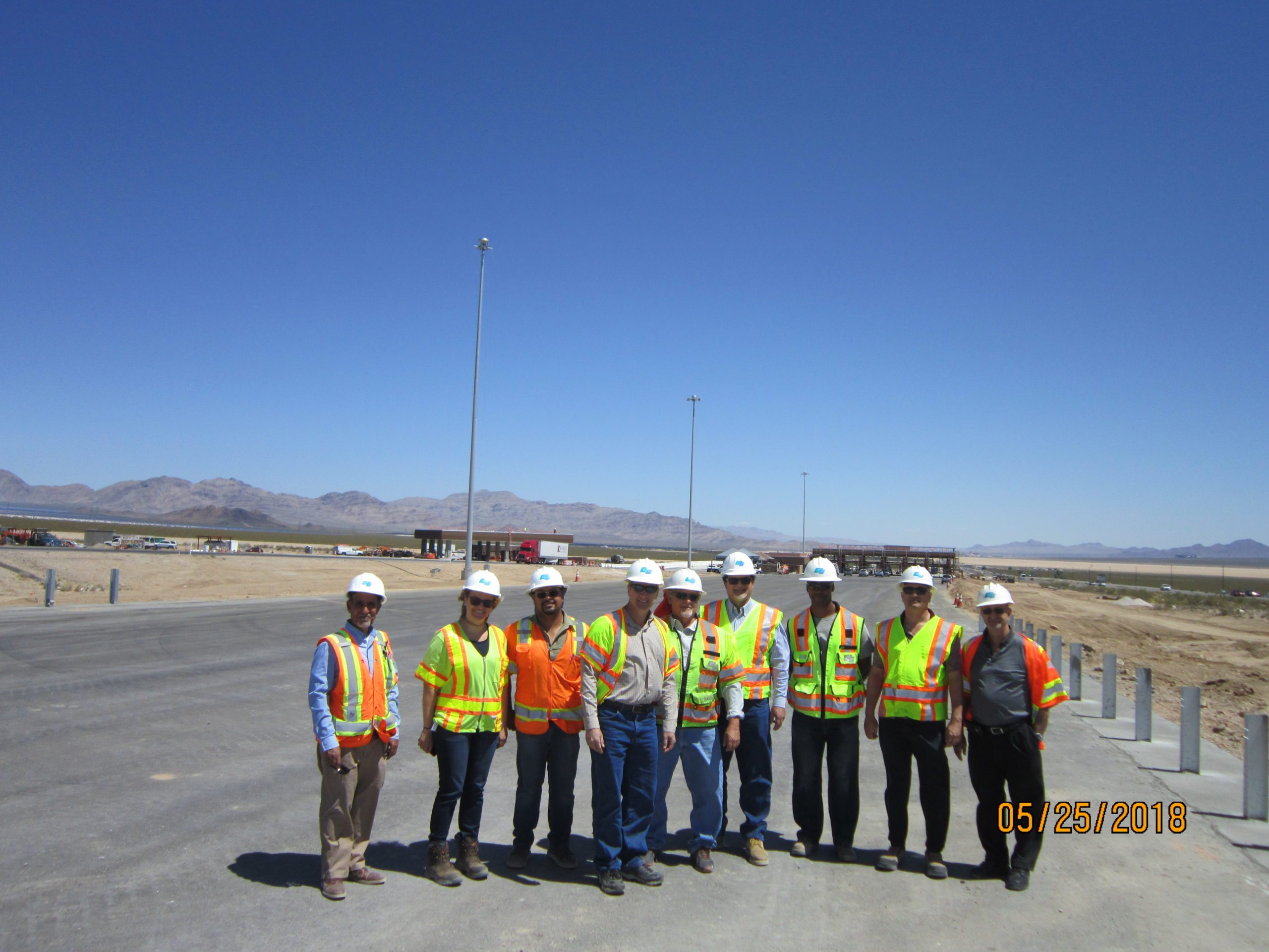 The GLA team stands for a group photo with Caltrans construction workers